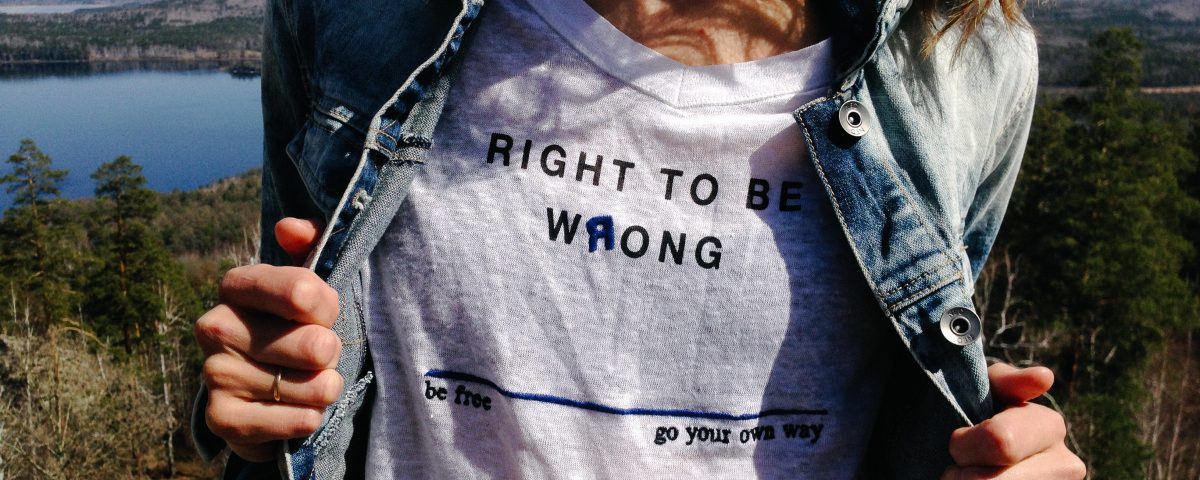 "Lady wearing a shirt that says ""right to be wrong...live free...go your own way..."""